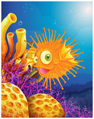 An orange puffer fish near the coral reefs — Stock Vector