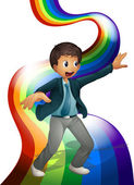 A boy dancing above the rainbow — Stock Vector