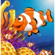 A school of fish near the beautiful coral reefs — Stock Vector #40578473