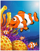 A school of fish near the beautiful coral reefs — Stock Vector