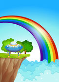 A saucer at the cliff and a rainbow in the sky — Stock Vector