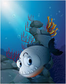 A scary piranha near the rocks — Stock Vector