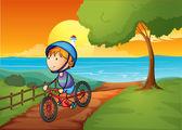 A young boy biking near the river — Stock Vector