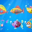A group of colorful smiling fishes — Stock Vector #40935185