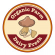 A round organic farm and dairy fresh logo with a mushroom — Stock Vector