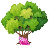 A pink monster resting under the tree — Stock Vector