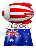 The flag of Australia attached to the floating balloon — Stock Vector