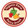A round dairy fresh and organic farm logo with bell peppers — Stock Vector