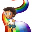 A boy dancing above the rainbow — Stock Vector #40945191