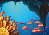 A school of fishes going to the coral reefs inside the cave — Stock Vector