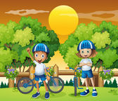 Two adorable kids biking — Stock Vector