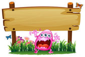 A scared pink monster under the wooden signboard — Stock Vector