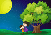 A mother and her daughter near the tree — Stock Vector