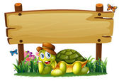 A smiling turtle below the empty wooden board — Stock Vector