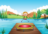 A boy playing with the trampoline at the river — Stock Vector