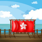 A wooden frame at the bridge with the flag of Hong Kong — Stock Vector