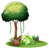A fat green monster sleeping under the tree — Stock Vector