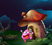 A pink monster near the mushroom house — Stock Vector