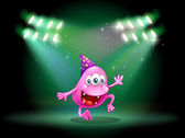 A monster dancing in the middle of the stage — Stock Vector
