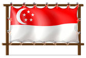 The flag of Singapore attached to the wooden frame — Stock Vector