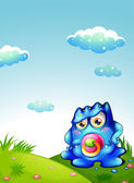 A baby blue monster at the hilltop — Stock Vector