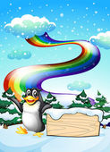 A penguin near the empty signboard and a rainbow in the sky — Stock Vector
