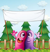 Two loving monsters under the empty banner — Stock Vector