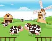 Goats at the farm with a windmill — Stock Vector