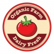 A tomato with a dairy fresh and organic farm label — Stock Vector