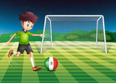A boy kicking the ball with the flag of Mexico — Stock Vector