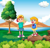 Two kids at the riverside — Stock Vector