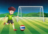 A soccer player kicking the ball with the flag of Thailand — Stock Vector