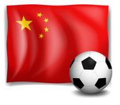 A soccer ball in front of the Chinese flag — Stock Vector