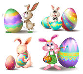 Bunnies with Easter eggs — Stock Vector