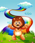 A happy lion at the hilltop with a rainbow in the sky — Stock Vector