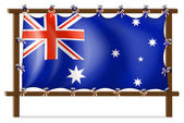 The flag of Australia attached to the wooden frame — Stock Vector