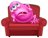 A couch with a pink monster — Stock Vector