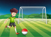 A player kicking the ball with the flag of Indonesia — Stock Vector