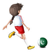 A girl kicking the ball with the flag of Pakistan — Stock Vector