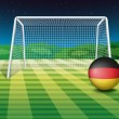 A soccer ball near the net with the flag of Germany — Stock Vector #43027223