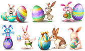 Easter eggs with playful bunnies — Stock Vector