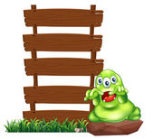A monster above the rock beside the empty wooden signboards — Stock Vector
