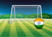 A soccer ball near the net with the flag of India — Stock Vector