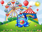 A baby monster at the hilltop with a carnival — Stock Vector