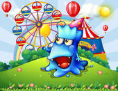 A happy blue monster at the hilltop with a carnival — Stock Vector