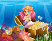 A mermaid under the sea beside the treasures — Stock Vector