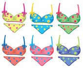 Colorful dotted bikinis — 图库矢量图片