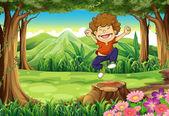 A joyful boy at the jungle — Stock Vector