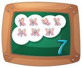 A blackboard with seven butterflies — Stock Vector
