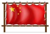 A wooden frame with the Chinese flag — Stock Vector